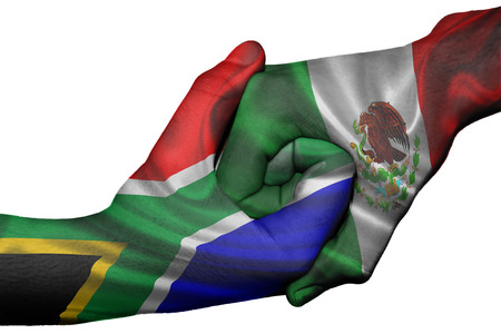 diplomatic: Diplomatic handshake between countries: flags of South Africa and Mexico overprinted the two hands Stock Photo