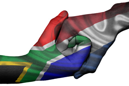 Diplomatic handshake between countries: flags of South Africa and Netherlands overprinted the two hands photo
