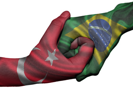 Diplomatic handshake between countries: flags of Turkey and Brazil overprinted the two hands photo