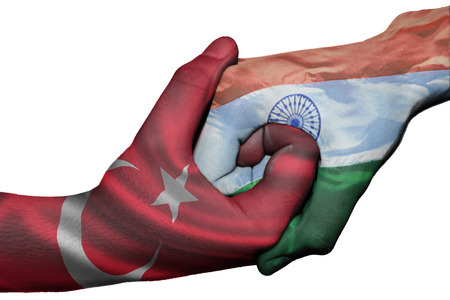 Diplomatic handshake between countries: flags of Turkey and India overprinted the two hands photo