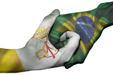 Diplomatic handshake between countries: flags of Vatican City and Brazil overprinted the two hands photo