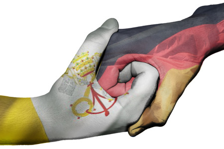 Diplomatic handshake between countries: flags of Vatican City and Germany overprinted the two hands photo