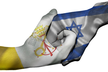 Diplomatic handshake between countries: flags of Vatican City and Israel overprinted the two hands