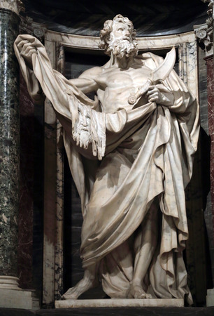 Statue of Bartholomew the apostle into a niche in the Archbasilica of St. John Lateran, Rome Italy