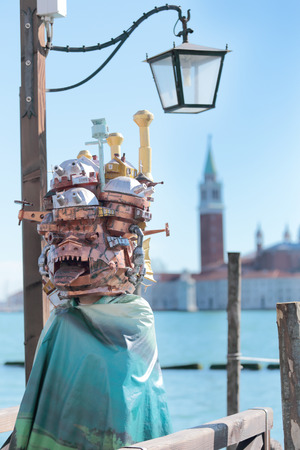 odd: Odd mask with buildings exhibited during the traditional Carnival of Venice, Italy (2014 edition)