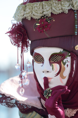 hushing: A masked lady hushing exhibited during the traditional festival of Carnival of Venice, Italy (2014 edition)