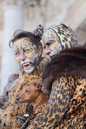 VENICE, ITALY - February 23: An unidentified couple with a dog is disguised as a leopard during the traditional festival of Carnival on February 23, 2014 in Venice, Italy