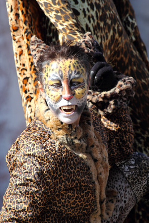 enigma: VENICE, ITALY - February 23: An unidentified woman with a dog is disguised as a leopard during the traditional festival of Carnival on February 23, 2014 in Venice, Italy