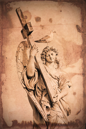 Retro and vintage styled image of a marble statue of an Angel near Saint Angel Bridge in Rome, with a cross in arms and a seagull on the head. A grunge texture is applied as background photo