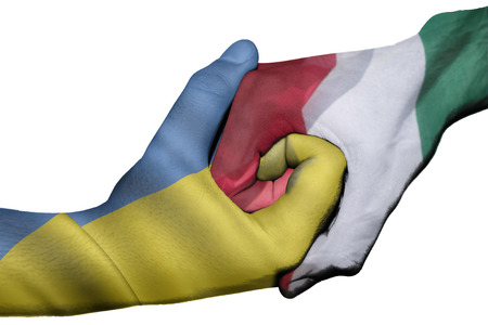 diplomatic: Diplomatic handshake between countries: flags of Ukraine and Italy overprinted the two hands Stock Photo