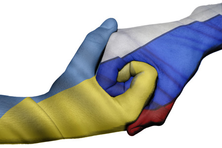 diplomatic: Diplomatic handshake between countries: flags of Ukraine and Russia overprinted the two hands