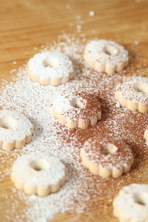 Italian canestrelli biscuits sprinkled with powdered sugar and cocoa. Vertical image Stock Photo
