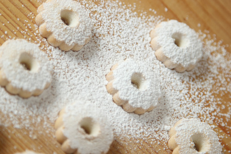 Italian canestrelli biscuits sprinkled with powdered sugar on its surface. Horizontal image