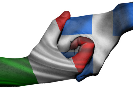 diplomatic: Diplomatic handshake between countries: flags of Italy and Greece overprinted the two hands