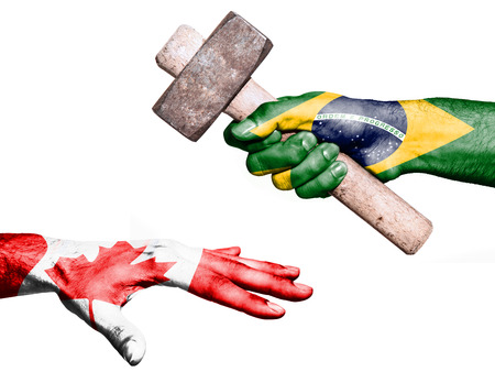 maul: Flag of Brazil overprinted on a hand holding a heavy hammer hitting a hand representing the Canada. Conceptual image for political, fiscal or social aggressions, penalties, taxation