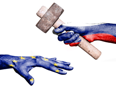 fiscal: Flag of Russia overprinted on a hand holding a heavy hammer hitting a hand representing the European Union. Conceptual image for political, fiscal or social aggressions, penalties, taxation Stock Photo