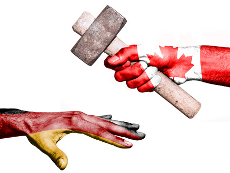 fiscal: Flag of Canada overprinted on a hand holding a heavy hammer hitting a hand representing the Germany. Conceptual image for political, fiscal or social aggressions, penalties, taxation