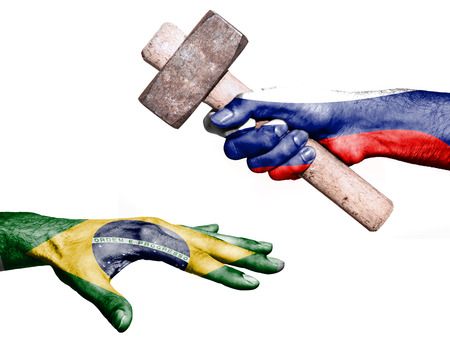 fiscal: Flag of Russia overprinted on a hand holding a heavy hammer hitting a hand representing the Brazil. Conceptual image for political, fiscal or social aggressions, penalties, taxation
