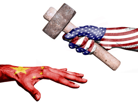 fiscal: Flag of United States overprinted on a hand holding a heavy hammer hitting a hand representing the China. Conceptual image for political, fiscal or social aggressions, penalties, taxation Stock Photo