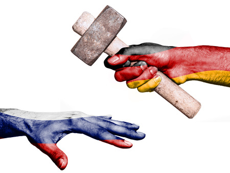 maul: Flag of Germany overprinted on a hand holding a heavy hammer hitting a hand representing the Russia. Conceptual image for political, fiscal or social aggressions, penalties, taxation