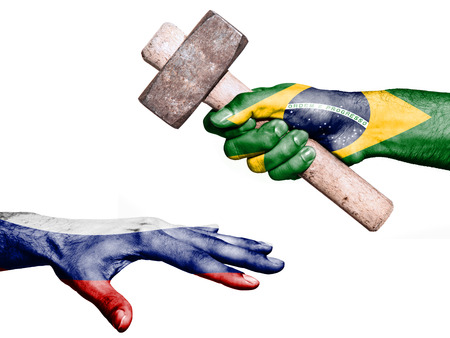 maul: Flag of Brazil overprinted on a hand holding a heavy hammer hitting a hand representing the Russia. Conceptual image for political, fiscal or social aggressions, penalties, taxation Stock Photo