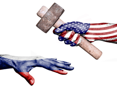 fiscal: Flag of United States overprinted on a hand holding a heavy hammer hitting a hand representing the Russia. Conceptual image for political, fiscal or social aggressions, penalties, taxation Stock Photo