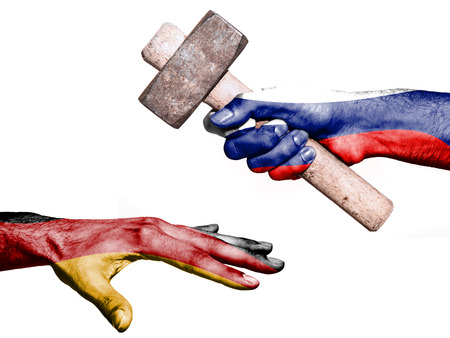 maul: Flag of Russia overprinted on a hand holding a heavy hammer hitting a hand representing the Germany. Conceptual image for political, fiscal or social aggressions, penalties, taxation Stock Photo