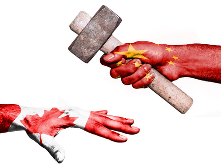 fiscal: Flag of China overprinted on a hand holding a heavy hammer hitting a hand representing the Canada. Conceptual image for political, fiscal or social aggressions, penalties, taxation