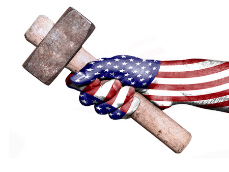 work workman: National flag of United States overprinted the hand of a man handling a heavy hammer isolated on a white background. Conceptual image for work, job, workman