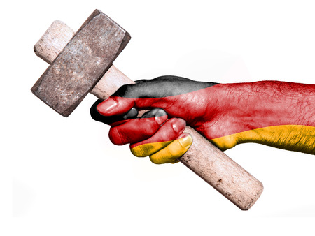 work workman: National flag of Germany overprinted the hand of a man handling a heavy hammer isolated on a white background. Conceptual image for work, job, workman