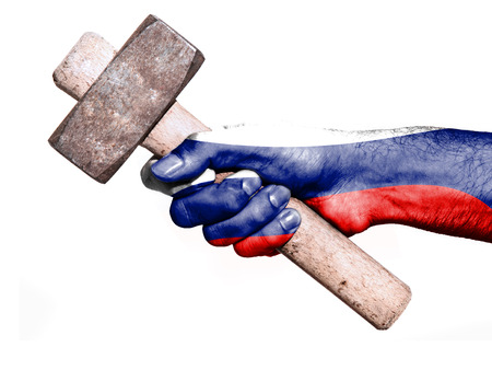 work workman: National flag of Russia overprinted the hand of a man handling a heavy hammer isolated on a white background. Conceptual image for work, job, workman Stock Photo