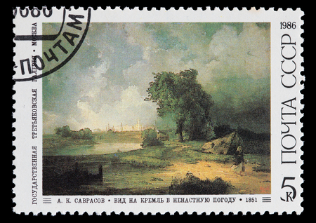 inclement weather: SOVIET UNION - CIRCA 1986: A postage stamp printed in Soviet Union shows a work of A. Savrasov: View of the Kremlin in inclement weather, circa 1986