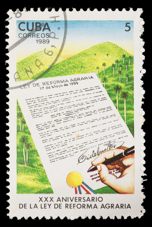 agrarian: CUBA - CIRCA 1989: A postage stamp printed in Cuba shows the anniversary of the signature of the law of agrarian reform, circa 1989
