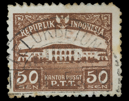 philatelic: INDONESIA - CIRCA 1954: A postage stamp printed in Indonesia shows the P.T.T. Headquarters, circa 1954