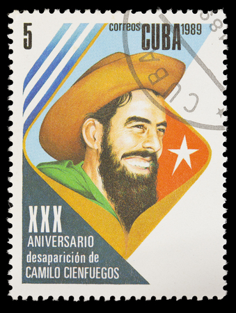 postage stamps: CUBA - CIRCA 1989: A postage stamp printed in Cuba shows the Cuban Revolution with the portrait of Camilo Cienfuegos, circa 1989