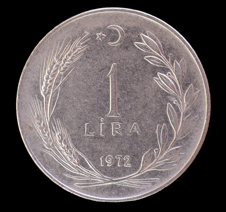 revaluation: One old turkish lira coin, issued from Turkey in 1972. This currency has been strongly devaluated before the revaluation in 2005. Image isolated on black background
