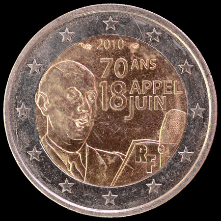 circulated: A commemorative circulated two euro coin issued by France in 2010 and showing the portrait of General de Gaulle to celebrate 70th anniversary of the Appeal of June 18. Image isolated on black background.