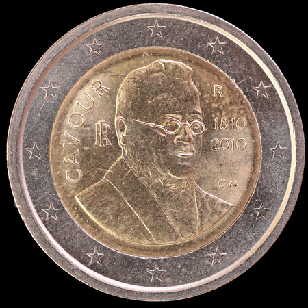 camillo: A commemorative circulated two euro coin issued by Italy in 2010 and depicting the portrait of Camillo Benso, Count of Cavour, to celebrate the 200th anniversary of the birth. Image isolated on black background.