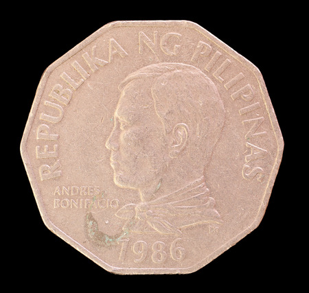 issued: The head face of a 2 piso coin, issued by the Republic of the Philippines in 1986, depicting the portrait of the national hero Andres Bonificio y de Castro, the First President. Image isolated on black background