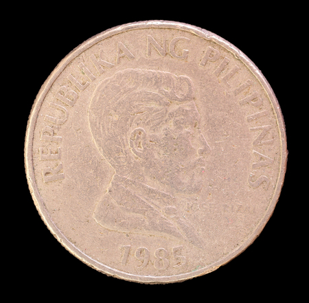 issued: The head face of a 2 piso coin, issued by the Republic of the Philippines in 1986, depicting the portrait of the national hero Jose Rizal. Image isolated on black background