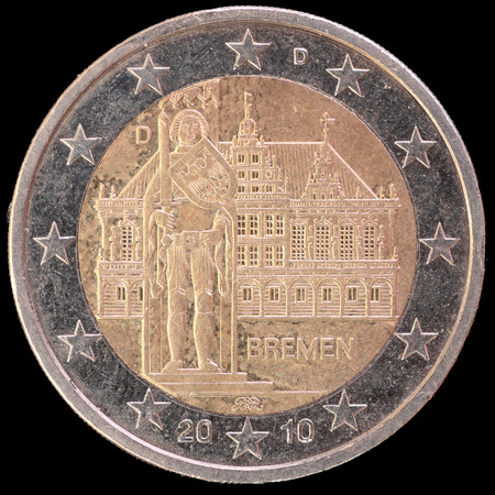 circulated: A commemorative circulated two euro coin issued by Germany in 2010 and celebrating the federal state of Bremen. Image isolated on black background.