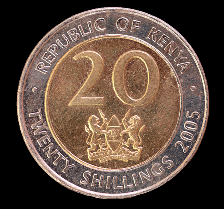 shilling: The head face of a 20 shilling coin, issued by the Republic of Kenya in 2005, depicting the national emblem of Kenya. Image isolated on black background