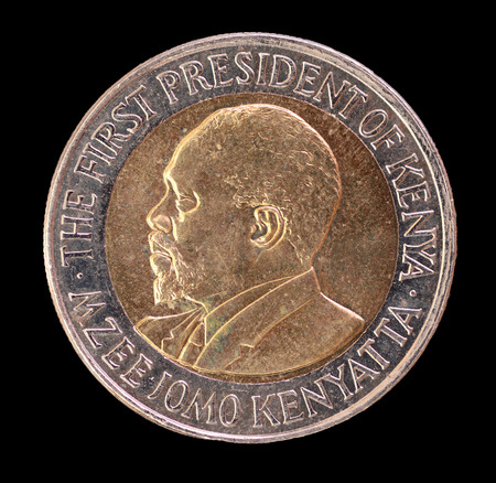 shilling: The head face of a 20 shilling coin, issued by the Republic of Kenya in 2005, depicting the portrait of the First President Mzee Jomo Kenyatta. Image isolated on black background