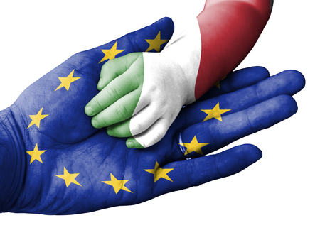 aiding: European Union flag overlaid the hand of an adult man holding a baby hand with the flag of Italy overprinted. Conceptual image for help, aid, assistance, rescue. Isolated on white background