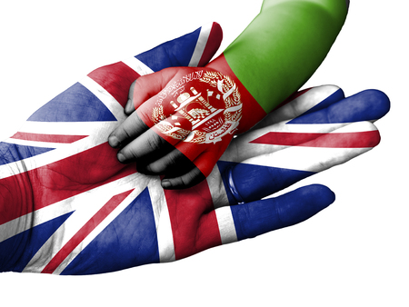 aiding: Flag of United Kingdom overlaid the hand of an adult man holding a baby hand with the flag of Afghanistan overprinted. Conceptual image for help, aid, assistance, rescue. Isolated on white background