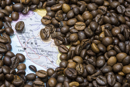 producers: Geographical map of Peru covered by a background of roasted coffee beans. This nation is between the ten main producers and exporters of coffee. Horizontal image.