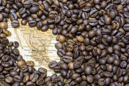 producers: Vintage map of Mexico covered by a background of roasted coffee beans. This nation is between the ten main producers and exporters of coffee. Horizontal image.