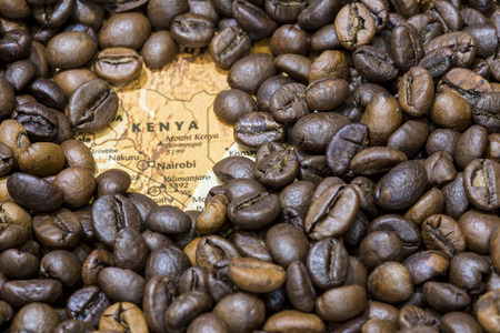 producers: Vintage map of Kenya covered by a background of roasted coffee beans. This nation is one of the main producers and exporters of coffee. Horizontal image. Stock Photo