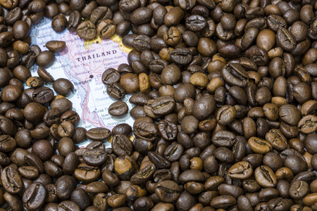 exporter: Geographical map of Thailand covered by a background of roasted coffee beans. This nation is one of the main producers and exporters of coffee. Horizontal image. Stock Photo