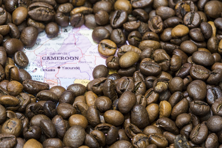 producers: Geographical map of Cameroon covered by a background of roasted coffee beans. This nation is one of the main producers and exporters of coffee. Horizontal image.
